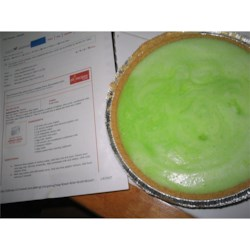 Key Lime Pie III Recipe - This pie 's filling is made with lime gelatin, a splash of bitters, lime juice, condensed milk, and fluffy egg whites folded in. Then it 's poured into a baked pie shell and chilled overnight.