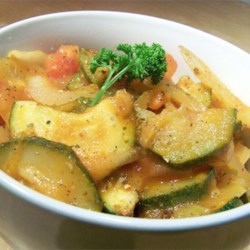 Italian Zucchini Saute Recipe - This is just like Nonni used to make! Fresh zucchini, onions, and tomatoes sauteed with Italian seasonings make a perfect complement to any meal. Serve alone or over rice.