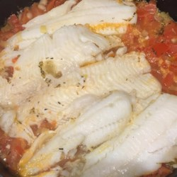 Sole Steamed with Tomato-Leek Sauce Recipe - Delicate sole fillets are simmered in a sauce of thyme, dill, tomato, and wine.