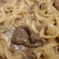 Creamy Beef Tips with Egg Noodles Recipe - Cubed sirloin tips baked in cream of mushroom soup, red wine, milk, mixed with beef and beef onion soup mix. Served over egg noodles.