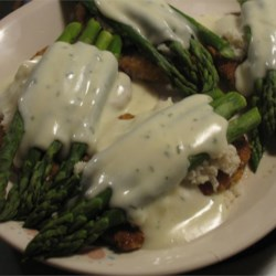 Veal Oscar Recipe - Breaded veal cutlets served with crab and asparagus and a cheddar cheese sauce.