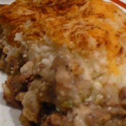 Shepherd's Pie IV Recipe - Steamed, fresh green beans, cauliflower and cheddar cheese are layered over a mixture of ground beef and onion. Then the mixture is smothered with cream of mushroom soup, and topped with mashed potatoes that have been whipped with garlic powder and cream cheese.