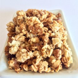 Maple Granola Recipe - Homemade maple granola with pecans and coconut oil is a hearty and crunchy cereal you can eat alone and sprinkle over yogurt or ice cream.