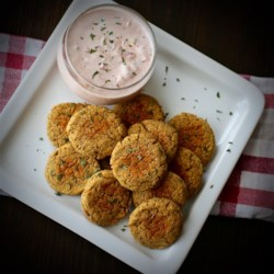 Simple Falafel (Chickpea Burgers) Recipe - This quick and easy falafel is baked in the oven and served alongside a sour cream and salsa dip for a great weeknight meal.