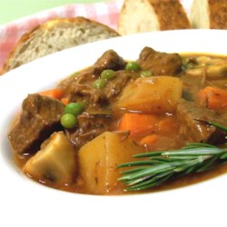 Beef and Vegetable Stew Recipe - Button mushrooms and peas are the final ingredients added to this low-fat  rosemary seasoned stew.  Serve as is or over cooked noodles.