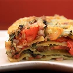 Sauceless Garden Lasagna Recipe - I developed this tasty lasagna to help use up the tomatoes, spinach, and zucchini from my garden. With no pasta sauce on hand, I just added herbs to the vegetables.