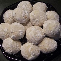 Nut Butter Balls Recipe - Rich and buttery.  If you don't have almond extract, you can use 2 teaspoons of vanilla in its place. Any type of nuts can be used in place of the walnuts.