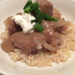 Slow Cooker Beef Tips and Rice Recipe - Simmer a flavorful beef rump roast in beef broth for hours until tender and serve with savory gravy over brown rice for a hearty meal made in the slow cooker.