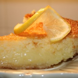 Bill Clinton's Lemon Chess Pie Recipe - Lemon juice and the zest of three lemons make this chess pie divine. The filling is thickened with cornmeal, and is rich with whole milk and eggs.