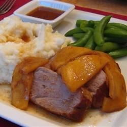 Pork Tenderloin with Apples Recipe - Pork tenderloin is cooked to perfection and served with a sauce made of fresh apples and Riesling wine in this simple, yet elegant dish.