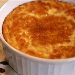 Thanksgiving Corn Pudding Recipe - This corn pudding made with canned corn, milk, sugar and flour is served cut into squares with a sweet butter sauce.
