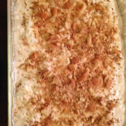 Ice Box Cake II Recipe - Graham cracker crumbs, whipping cream, marshmallows, bananas, nuts, and crushed pineapple make up this easy no-bake dessert.