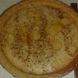 Sugar Cream Pie II Recipe - This pie is very sweet and creamy. Lots of sugar - both white and brown - and lots of evaporated milk are mixed with flour to make this pie 's filling. It 's poured into an unbaked pie crust, topped with a smidgen of butter and nutmeg, and baked.