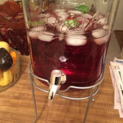 Cranberry Punch Recipe - Cranberry-apple juice mixed with ginger ale and garnished with slices of lime and sprigs of mint.