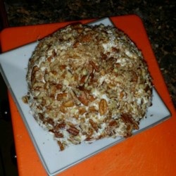 Pineapple Cheese Ball Recipe - Celery, bell pepper and onion are the unexpected ingredients in this otherwise sweet cheese spread.