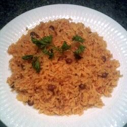 Easy Arroz con Gandules Recipe - Cilantro and other ingredients are whirred in the blender to create a seasoning base called soffrito used in this Latin rice and pigeon pea  - gandulas  - dish. Tomato sauce and soffrito impart a lovely flavor to the rice that is then cooked with the peas.