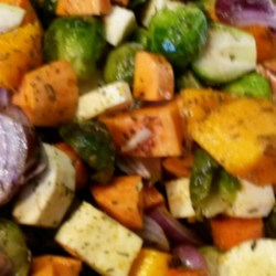 Seasoned Roasted Root Vegetables Recipe - Roasted root vegetables seasoned with thyme and rosemary are a colorful and hearty addition to the autumn dinner table.