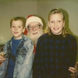 Jimmy and Jenny with Santa, I don't think this was the last photo we have with him either!