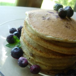 Whole Wheat Blueberry Pancakes Recipe - The blueberries in these whole wheat pancakes are so sweet and moist that they don't even need butter when eaten while hot!  This is our Saturday breakfast, healthy for me; yummy for husband and kids.