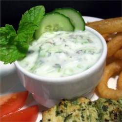 Cucumber Raita Recipe - Cucumber and mint make an amazingly refreshing salad when stirred together with Greek yogurt and lemon juice.