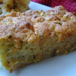 Zucchini Cornbread Casserole Recipe - Shredded zucchini baked with onions, corn muffin mix, and cheddar cheese.