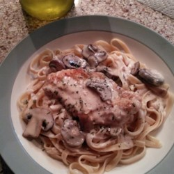 Champagne Chicken Recipe - A simple chicken saute coated in a sophisticated champagne-mushroom cream.  Ideal for entertaining.