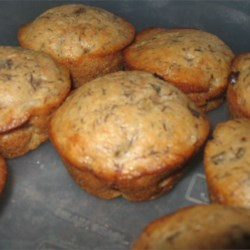 Banana Chip Muffins II Recipe - These tasty muffins are low in fat, but downright yummy.  As banana compensates for the texture of fat, no butter, oil or egg yolks are used in this recipe.  Chocolate chips make these muffins extra special.