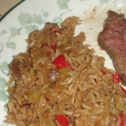 One Bowl Rice Recipe - Rice is baked with mushrooms, celery, red bell pepper, onion soup mix and beef broth, for a colorful and hearty side dish that will complement any meal.