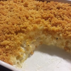 Chuck's Favorite Mac and Cheese Recipe and Video - Macaroni is mixed with shredded Cheddar, Parmesan, cottage cheese and sour cream, then topped with bread crumbs and baked.