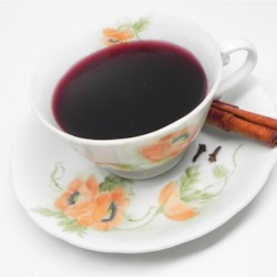 Hot Mulled Wine Recipe - Cloves, lemon, and cinnamon infuse this mulled wine with a delicious flavor that is perfect for holiday entertaining.