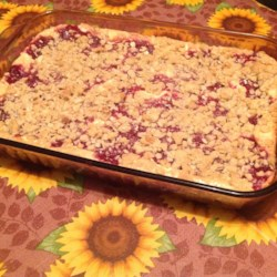 Cranberry Cheese Bars Recipe - A tasty layered bar cookie with an oaty crust, a cream cheese layer and a cranberry layer.