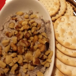 Blue Cheese, Port, and Walnut Spread Recipe - Blue cheese, Port and walnuts are pureed in a food processor before being transferred into an attractive serving dish (or crock).  Serve with crackers or baguette slices.  Refrigerated, this will keep for three weeks.