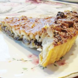 Hawaiian Chocolate Macadamia Nut Tart Recipe - The niu (coconut) really adds to this easy, modern, Hawaiian desert.  This is frequently served in lieu of pecan pie during the holidays.  It can be served warm with vanilla ice cream or cold with whipping cream, and can be made a day in advance of your Hawaiian feast!