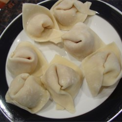 Mr. Kirk's Won Tons Recipe - Filled with pork, bok choy, bamboo shoots, and other wonderful ingredients, these tasty won tons make great party treats! When properly folded, finished wontons should resemble a nurse's cap.