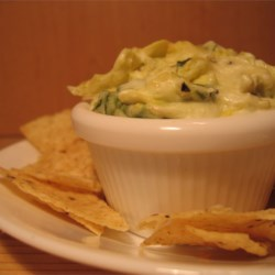 Hot Artichoke and Spinach Dip II Recipe - Who can deny the popularity of artichokes and spinach blended with cheeses? Try this hot, flavorful dip with toasted bread or tortilla chips.