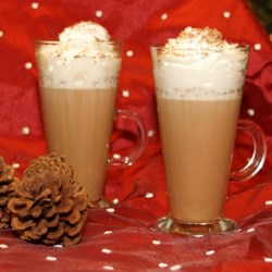 Holiday Cappuccino Recipe - Warm your tummy with a yummy combination of espresso with amaretto, brandy, and cocoa mix.