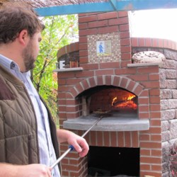 Wood-fired pizza oven. Every backyard needs one!