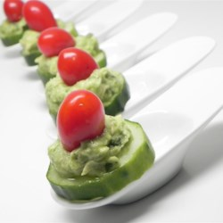 Avocado Basil Cucumber Bites Recipe - Cucumber slices are topped with an avocado-basil spread in these delightful cucumber bites perfect for appetizers or snacks.