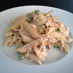 Chicken and Pea Casserole Recipe - A simple, quick casserole that's great for week-night meals with the family. It combines canned chunk chicken with mushroom soup, sour cream, peas, Parmesan cheese, rigatoni pasta, and seasonings.