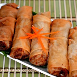 Authentic Vietnamese Spring Rolls (Nem Ran Hay Cha Gio) Recipe - Chicken, shrimp, and vegetables are rolled in rice paper wrappers and deep-fried in this authentic recipe for Vietnamese Cha Gio.