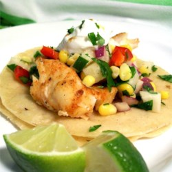Fiery Fish Tacos with Crunchy Corn Salsa Recipe - Spicy grilled fish are cooled down with a fresh crunchy veggie salsa featuring fresh corn. Your guests will swim back for seconds!