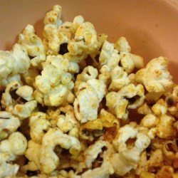 """""""Doritos(R)"""" Popcorn Recipe - Popcorn is coated with nutritional yeast, garlic powder, onion powder, and salt creating a Doritos(R)-flavored popcorn for a quick and easy snack."""