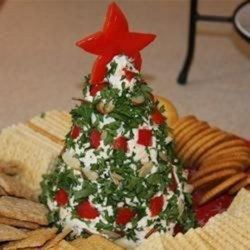 Christmas Tree Cheese Ball Recipe - Your cheese ball will be the hit of the party when you shape it into a Christmas tree shape and cover it with chopped parsley 'needles' and pecan and bell pepper 'garlands'.