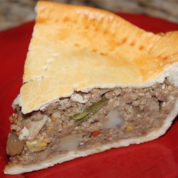 Millet Pie Recipe - Millet and oats are tossed with tamari, potatoes, and carrot and sandwiched between two pie crusts for a savory and flavorful millet pie.