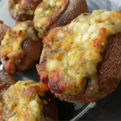 Stuffed Mushrooms III Recipe - Mushroom caps stuffed with a mixture of Italian cheeses and pesto.