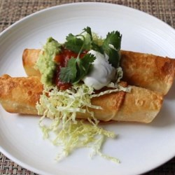 Crispy Turkey Flautas Recipe - Shredded leftover turkey (or chicken) and pepper Jack cheese--and not much more--is rolled into tortillas and quickly pan-fried in Chef John's Crispy Turkey Flautas.