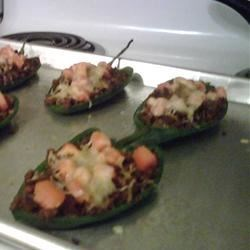 Vegetarian Stuffed Poblano Peppers Recipe - A tasty Mexican style vegetarian meal can be on the table in no time, just stuff fresh poblano peppers with seasoned soy crumbles, top with cheese and bake.