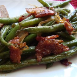Smothered Green Beans Recipe - Fresh green beans with a robust bacon, onion, and garlicky flavor.