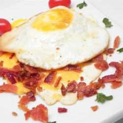 Laura's Breadless Fried Egg Sandwich Recipe - Crispy bacon and Cheddar cheese are sandwiched between two fried eggs in this quick and easy hearty breakfast dish for one.