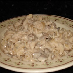 Beef Stroganoff II Recipe - Sirloin steak, condensed cream of mushroom soup, and paprika are combined with onions and nonfat sour cream for a different version of the traditional dish. It is served over egg noodles.